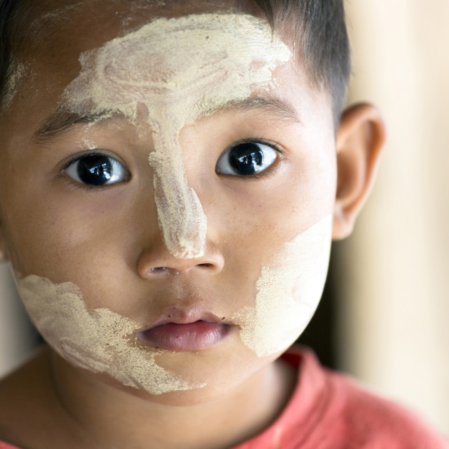 """Young Burmese child with Thanakha traditional face painting, Yangon..."" stock image"