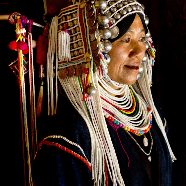 """Woman of the Akha tribe in traditional dress including a headdress of heavy..."" stock image"