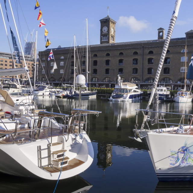 """Luxury boats are moored in St Katherine's Dock."" stock image"
