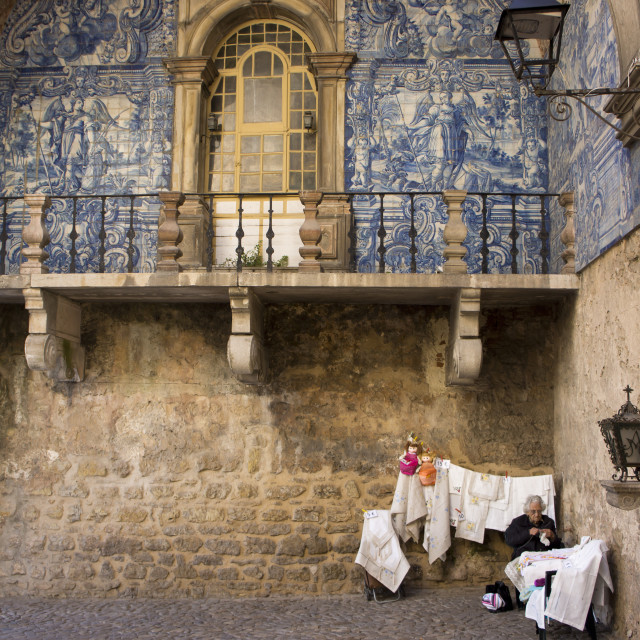 """""""Old lady selling embroidery in the walled medieval town of Obidos, declared..."""" stock image"""