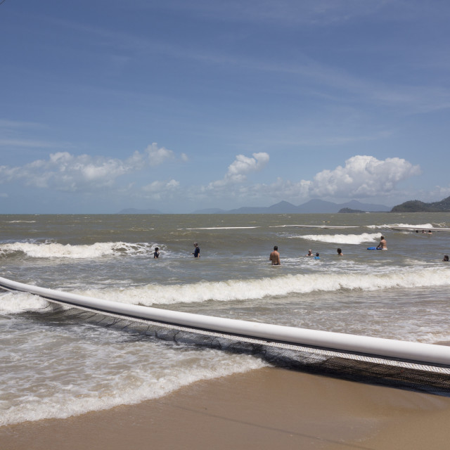 """""""People swimming within stinger protection net at Palm Cove, Cairns, North..."""" stock image"""