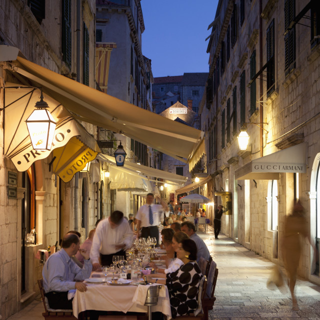 """People eating at outdoor restaurant at dusk in the old town, Dubrovnik,..."" stock image"