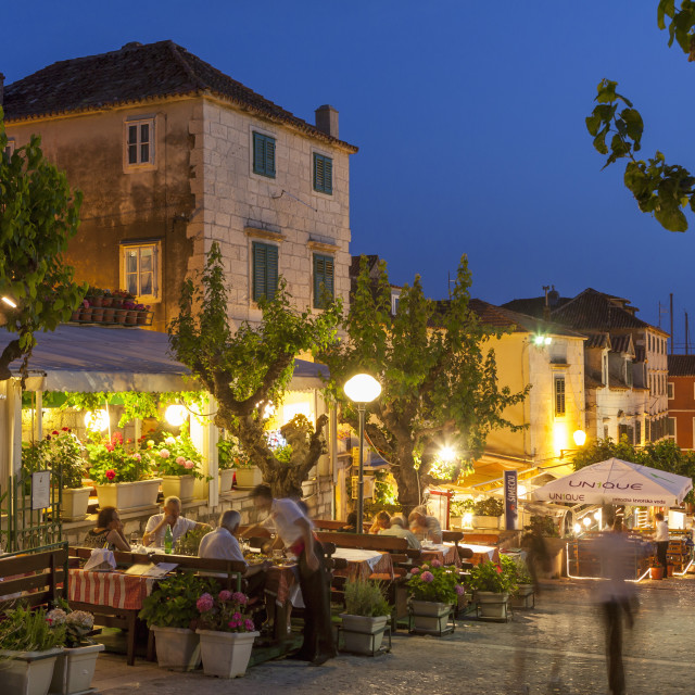 """Restaurants at dusk, Makarska, Dalmatian Coast, Croatia, Europe"" stock image"
