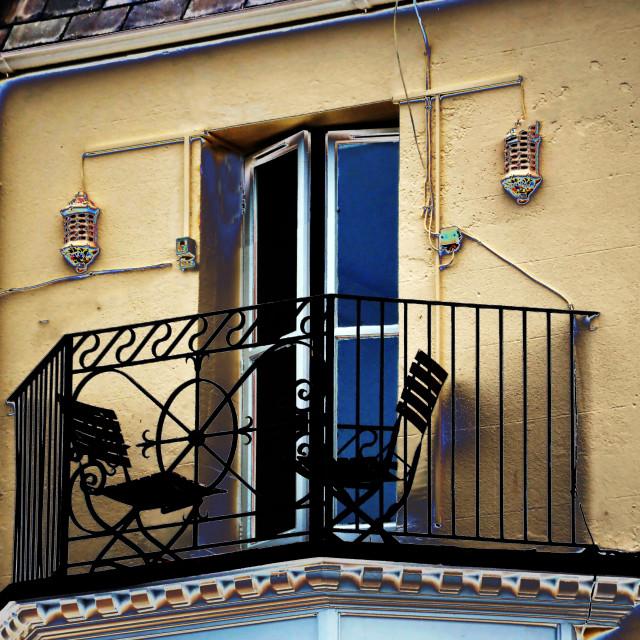 """Sitting on the balcony"" stock image"