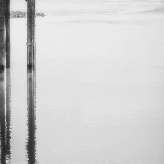 """Reflections of the old dock"" stock image"