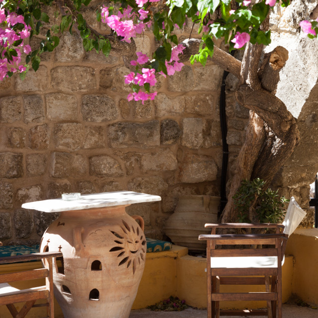 """A courtyard of a cafe in Rhodes town on the Greek island of Rhodes"" stock image"