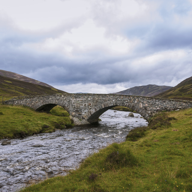 """Old stone bridge over a river in the Highlands of Scotland, United Kingdom"" stock image"