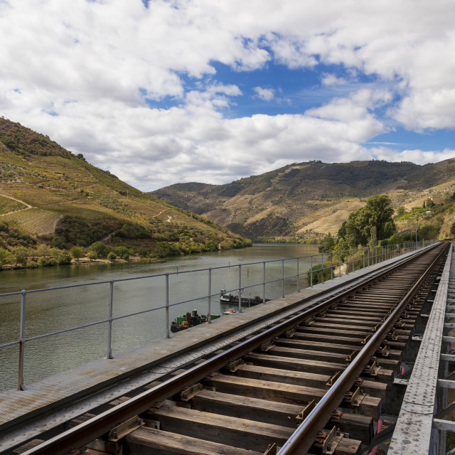 """Train tracks along the Douro River in the wine region of the Douro Valley in Portugal; Concept for travel in Portugal and in the Douro Region"" stock image"