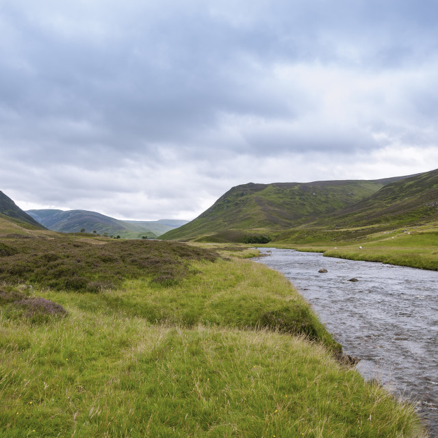 """View of a river in the Highlands of Scotland in United Kingdom in an overcast day; Concept for travel in Scotland"" stock image"
