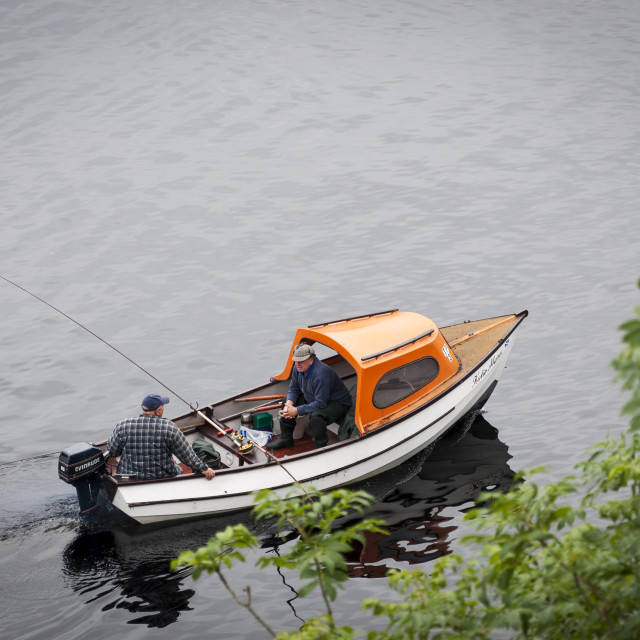 """Loch Ness, Scotland - August 14, 2010: Two fisherman in a boat in the Loch Ness, in Scotland, United Kingdom"" stock image"