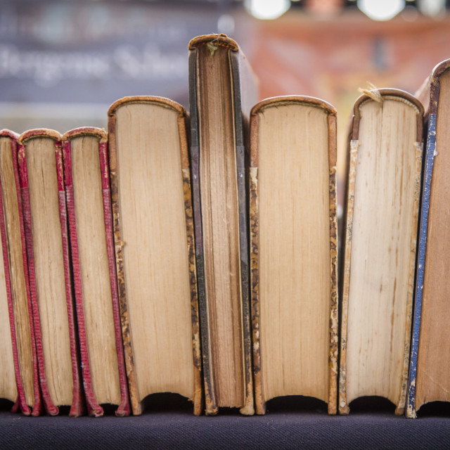 """""""Books resting against each other"""" stock image"""