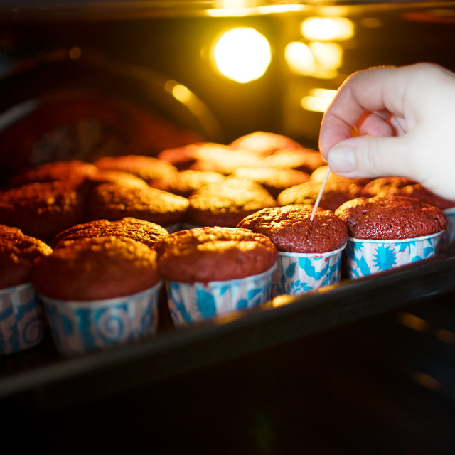 """""""Checking cupcakes for readiness background"""" stock image"""