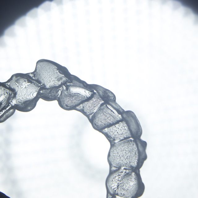 """Invisible teeth aligner bracket"" stock image"