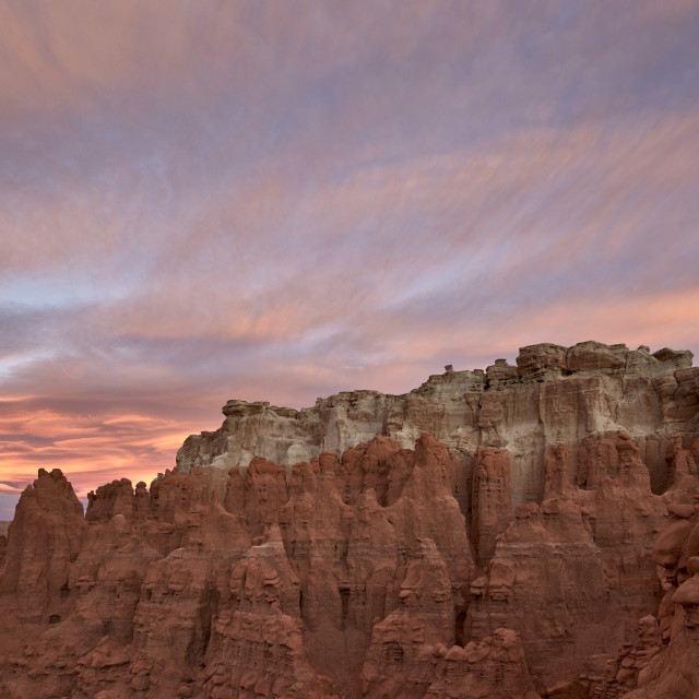 """Orange clouds at dawn over the badlands, Goblin Valley State Park, Utah,..."" stock image"