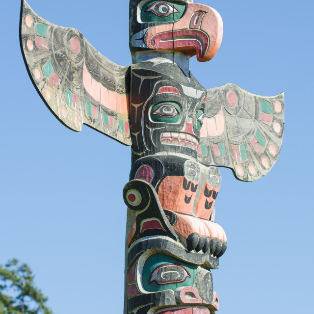 """Totem poles in cemetery in Alert Bay, British Columbia, Canada, North America"" stock image"