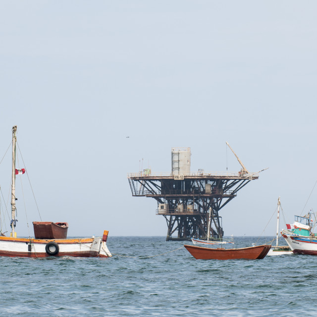 """""""Fishing boats and oil platform off Cabo Blanco, Peru, South America"""" stock image"""
