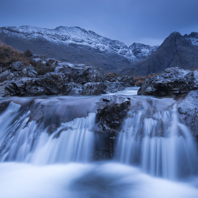 """""""Fairy Pools waterfalls at Glen Brittle, with the snow dusted Cuillin..."""" stock image"""