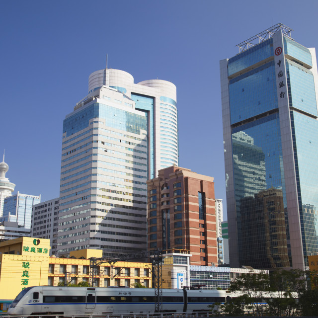 """""""High speed train passing skyscrapers, Shenzhen, Guangdong, China, Asia"""" stock image"""