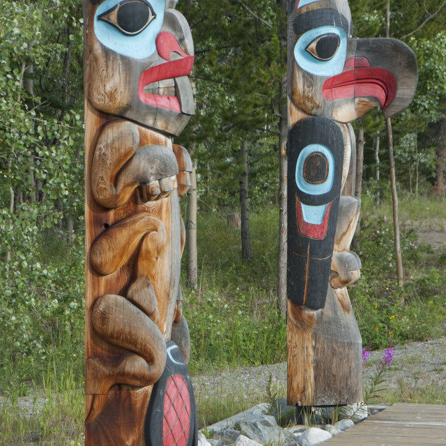 """Totem poles with beaver image on the left and eagle image on the right,..."" stock image"