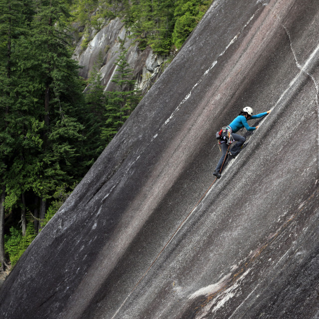 """A climber scales cliffs at Squamish Chief, Squamish, British Columbia,..."" stock image"