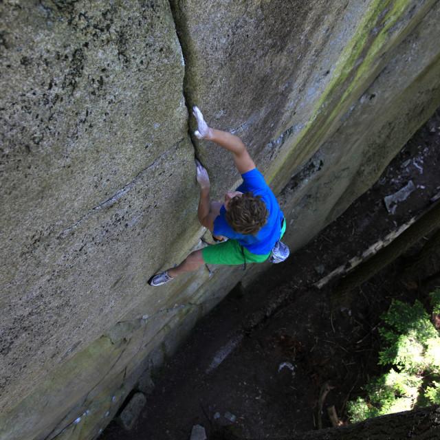 """A climber soloing a difficult crack climb, Squamish Chief, Squamish, British..."" stock image"