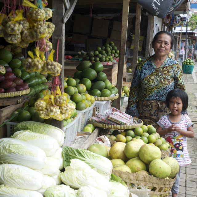 """""""Javanese stall holder and her daughter by their vegetable stall in the local..."""" stock image"""