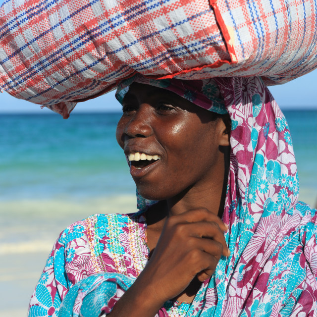 """Woman carrying package on head, Zanzibar, Tanzania, East Africa, Africa"" stock image"