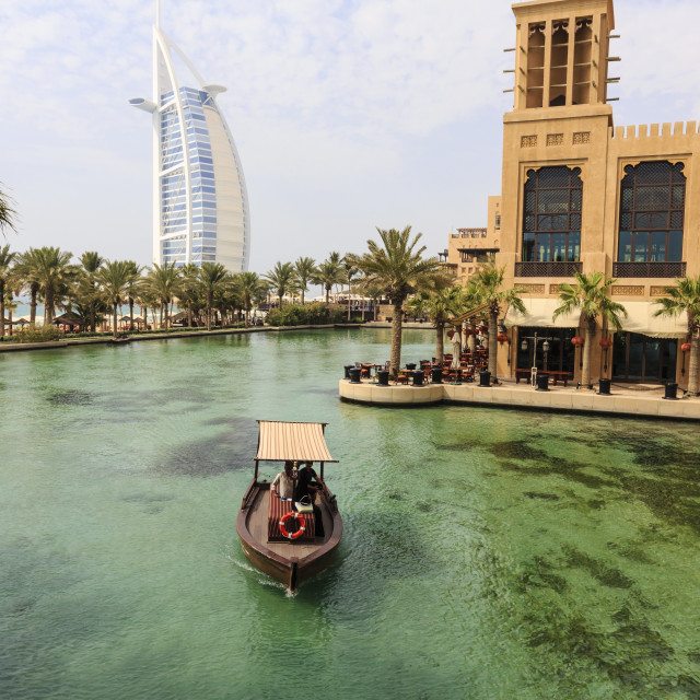 """""""Dhows cruise around the Madinat Jumeirah Hotel with Burj Al Arab in the..."""" stock image"""
