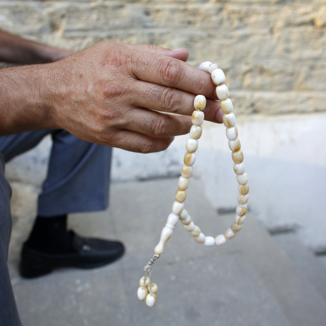 """Man holding prayer beads, Baku, Azerbaijan, Central Asia, Asia"" stock image"