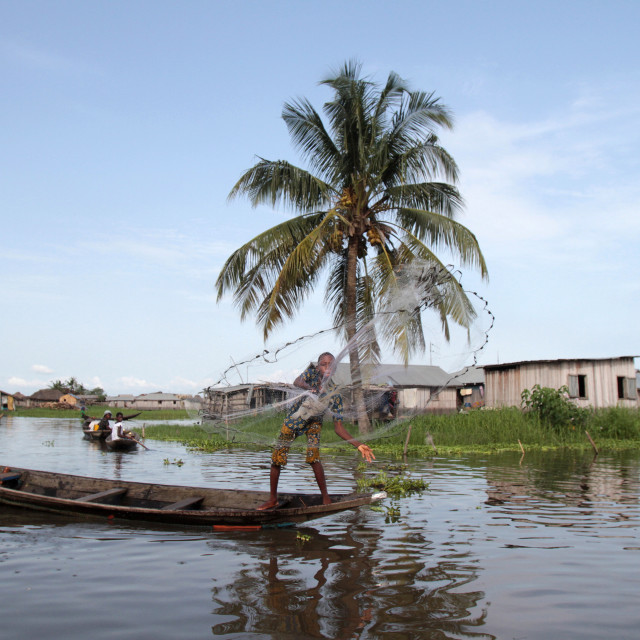 """African children fishing with a net from a canoe, Lake Nokoue, Ganvie, Benin,..."" stock image"