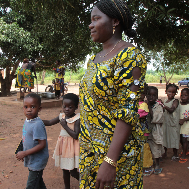 """""""Teacher accompanying students to school, Hevie, Benin, West Africa, Africa"""" stock image"""