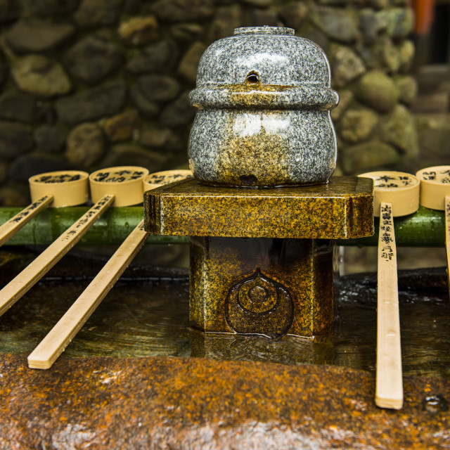 """""""Water dipper in the Endless Red Gates of Kyoto's Fushimi Inarii Shrine,..."""" stock image"""