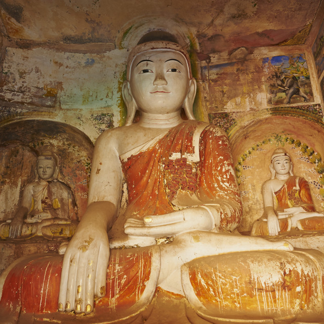 """Buddha statue in the Po Win Daung Buddhist cave, dating from the 15th..."" stock image"