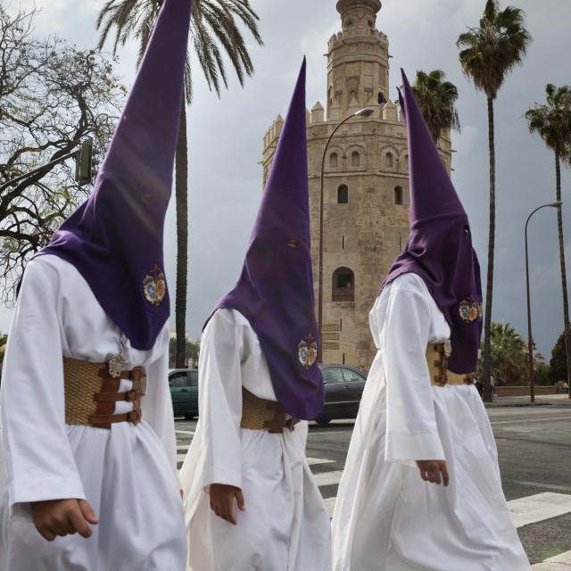 """Penitents during Semana Santa (Holy Week) beneath Torre del Oro, Seville,..."" stock image"