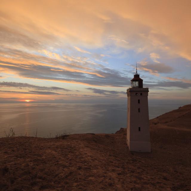 """Rubjerg Knude Fyr (lighthouse) buried by sand drift at sunset, Lokken,..."" stock image"