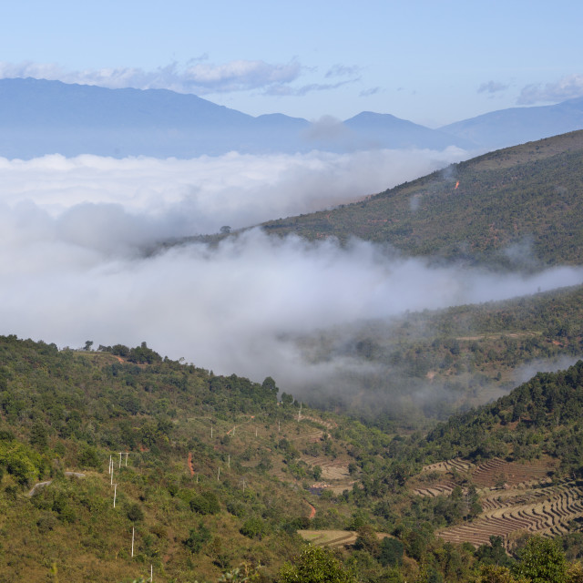 """""""Morning fog over Kengtung and Shan hills on road to Loimwe, near Kengtung,..."""" stock image"""