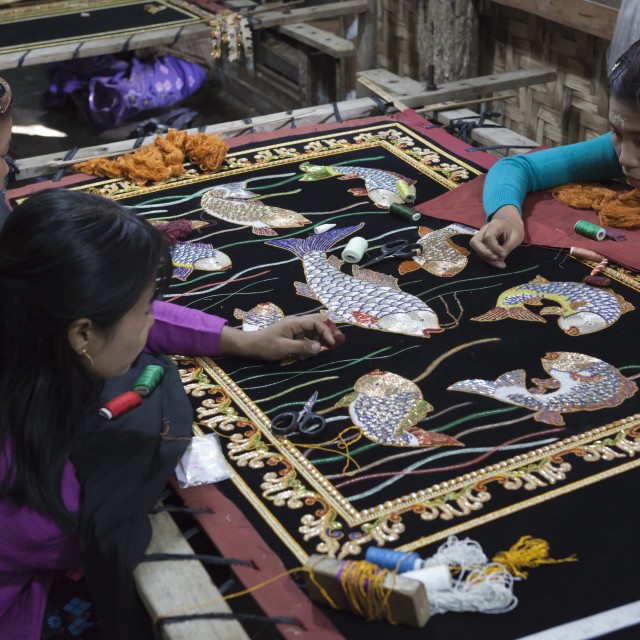 """Local women working on hand embroidered tapestry, Mandalay, Myanmar (Burma),..."" stock image"