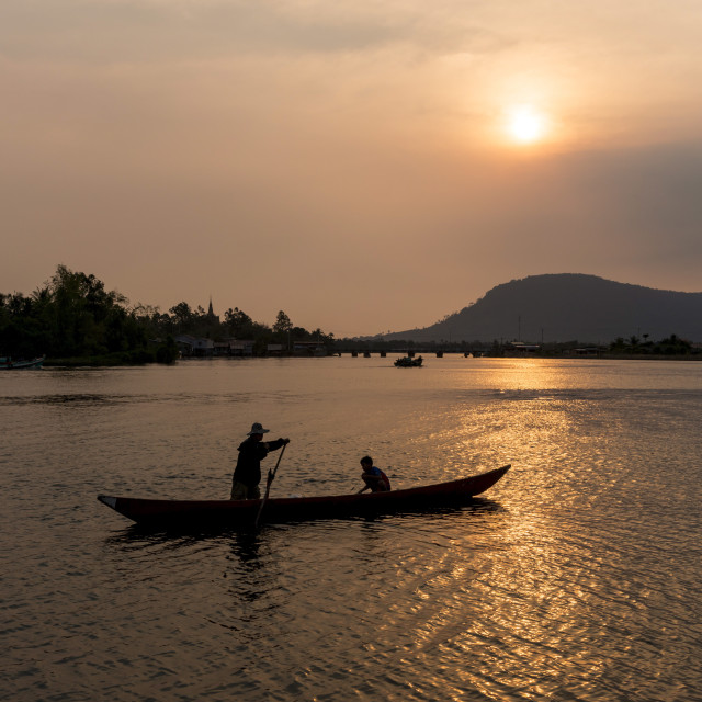 """Father and son fishing on Kampong Bay River at sunset, Kampot, Cambodia,..."" stock image"