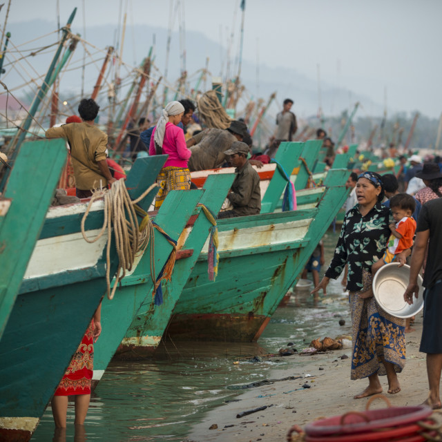 """Dawn at Kampot Harbour as fishing boats return with night's catch, Kampot..."" stock image"