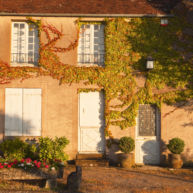 """""""A house in the village of Vezelay is lit by the setting sun."""" stock image"""