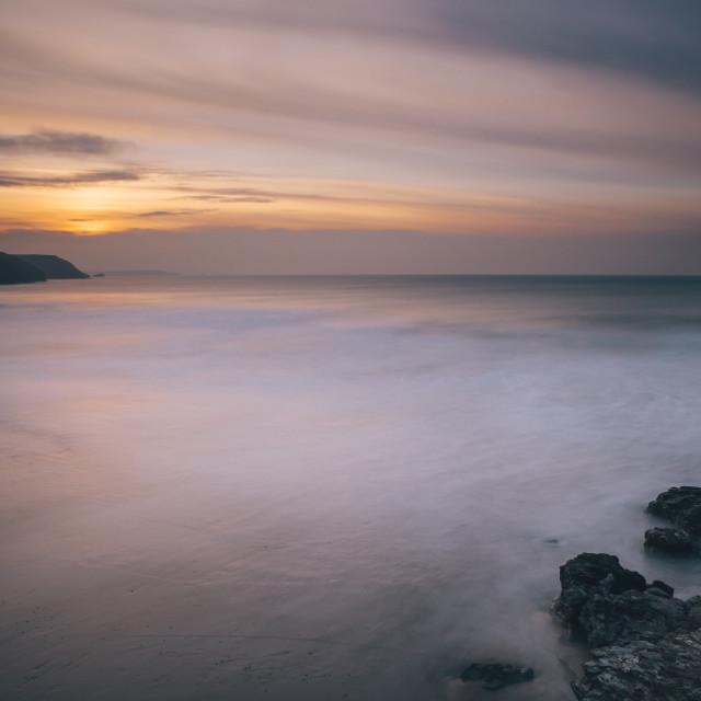 """Porthtowan beach looking along the Cornish coastline at sunset, Porthtowan,..."" stock image"