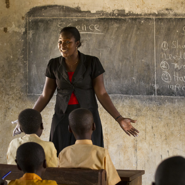 """A female teacher teaching science to a classroom of students at a primary..."" stock image"