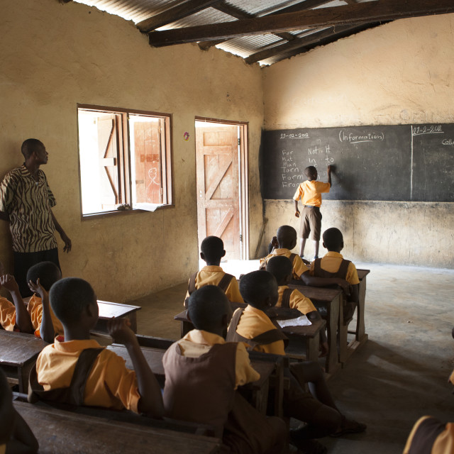 """A classroom of school children learning about the potential of cocoa farming."" stock image"