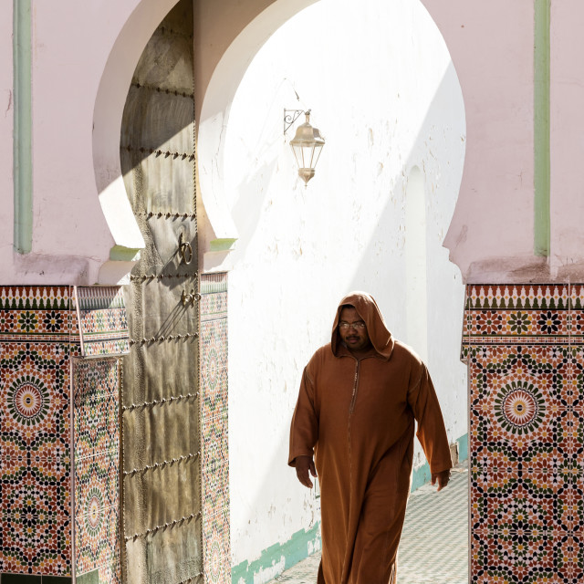 """""""Local man dressed in traditional Djellaba walking out of mosque in the..."""" stock image"""