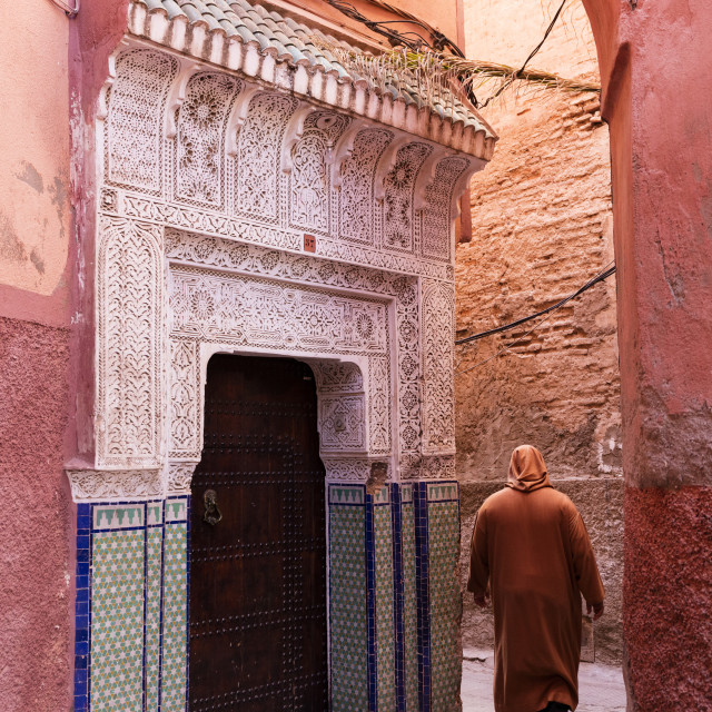 """""""Local man dressed in traditional Djellaba walking through street in the..."""" stock image"""