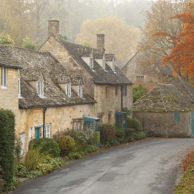 """Line of Cotswold stone cottages in Autumn mist, Snowshill, Cotswolds,..."" stock image"