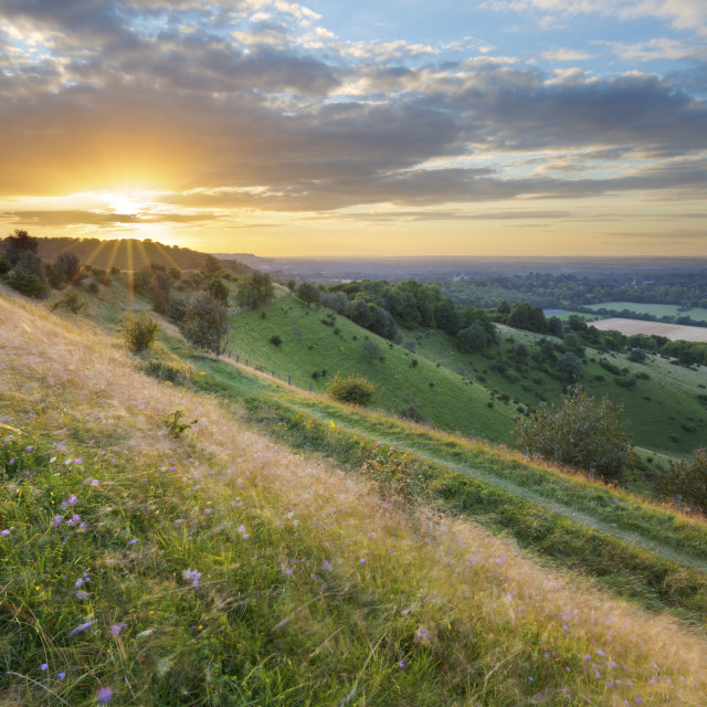 """Sunset over iron-age hill fort of Beacon Hill, near Highclere, Hampshire,..."" stock image"