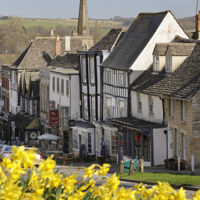 """High Street and Burford Church with Daffodils, Burford, Cotswolds,..."" stock image"