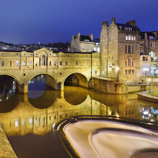 """Pulteney Bridge on the River Avon floodlit at night, Bath, Somerset, England,..."" stock image"
