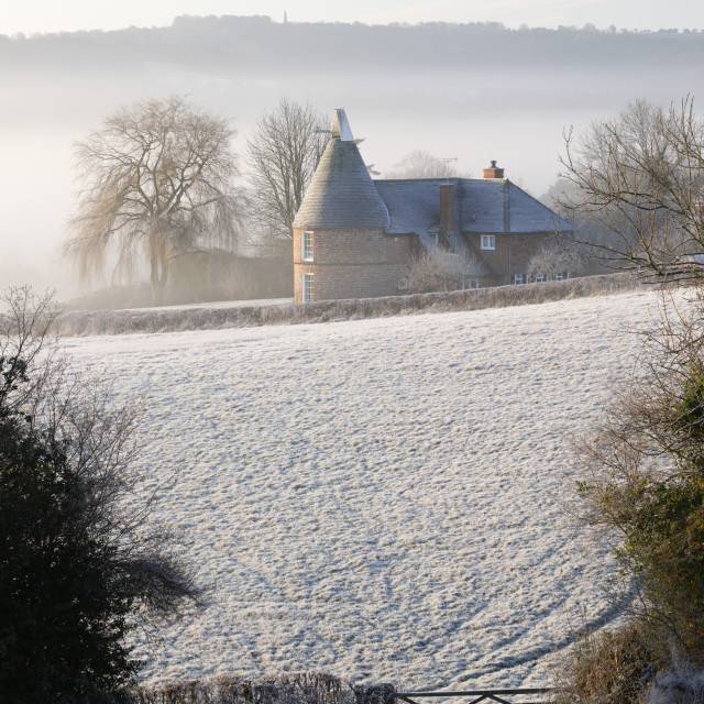 """Old oast house in winter frost, Burwash, East Sussex, England, United..."" stock image"